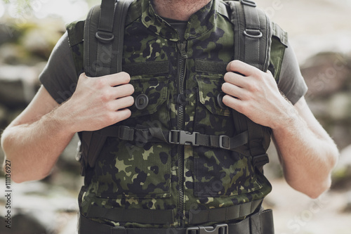 Valokuva close up of young soldier with backpack in forest