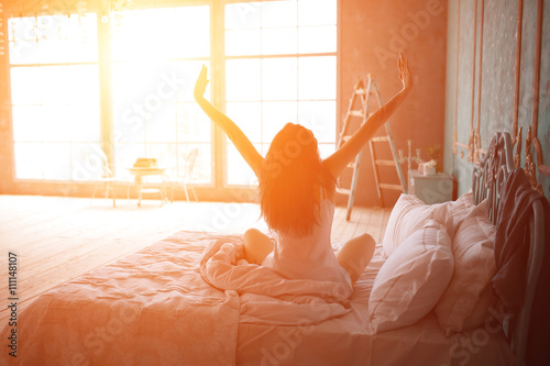 Fotografie, Obraz  Woman stretching in bed after wake up