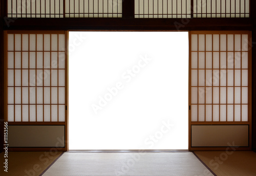Fotografia  Traditional Japanese wood and rice paper doors and tatami mat flooring
