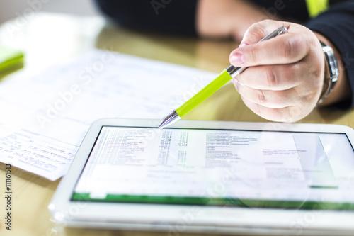 Fototapeta Accounting on a tablet computer, close-up obraz na płótnie