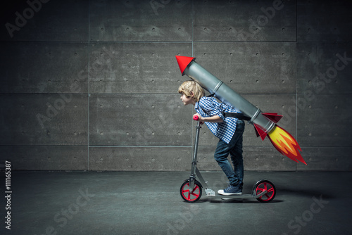 Obraz Boy on scooter - fototapety do salonu