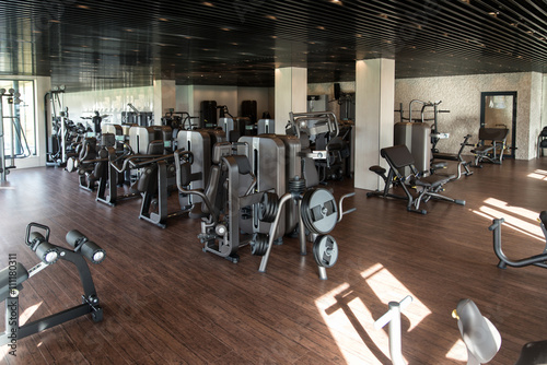 Fotobehang Fitness Exercise Machines In A Modern Gym