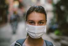 Young  Woman With Face Mask In...