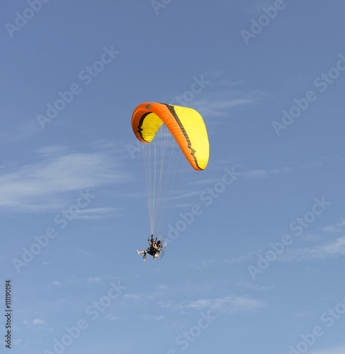 Tuinposter Luchtsport Paragliding in the sky and clouds