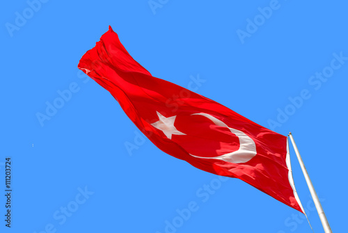 Photo  Waving Turkish flag on blue background