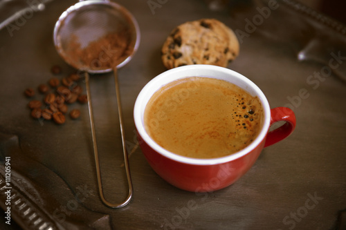 Cup of coffee with cookies on silver tray