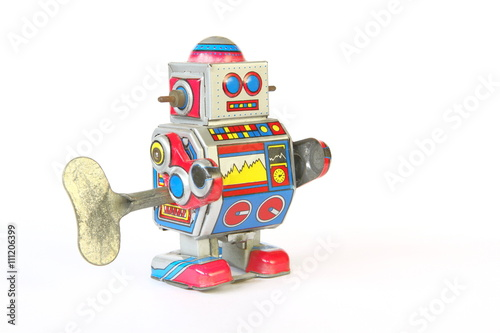Foto op Canvas UFO isolated vintage, retro tin robot toy, oblique view with key on white background