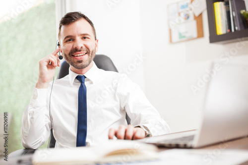 Telemarketer talking to customers with a smile