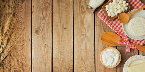 Tuinposter Zuivelproducten Farm fresh dairy products on wooden table. View from above. Flat lay