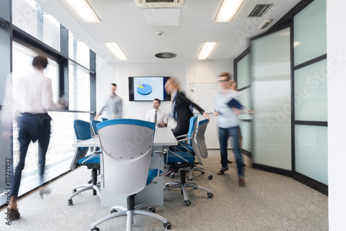 Fotografie, Obraz  business people group entering meeting room, motion blur