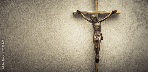 Foto Crucifix of Jesus on the cross with stone background