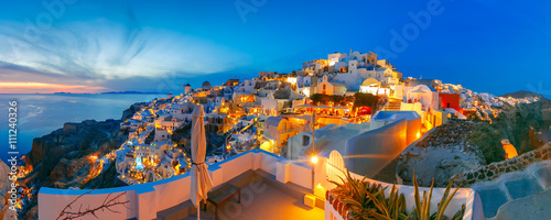 Foto auf Leinwand Santorini Panoramic famous view, Old Town of Oia or Ia on the island Santorini, white houses and windmills at sunset, Greece