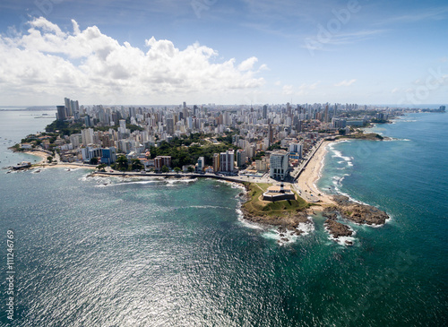 Fotografie, Obraz  Aerial view of Barra Lighthouse and Salvador cityscape, Bahia, Brazil