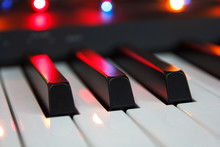 Piano Keyboard In A Festive Lighting