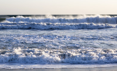The waves of the Pacific ocean, the beach landscape. The ocean and waves during strong winds in United States, Santa Monica.