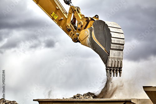 Construction industry excavator with portable quarry machine clo Wallpaper Mural