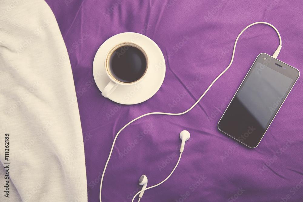Fototapeta coffee and phone on bed - obraz na płótnie