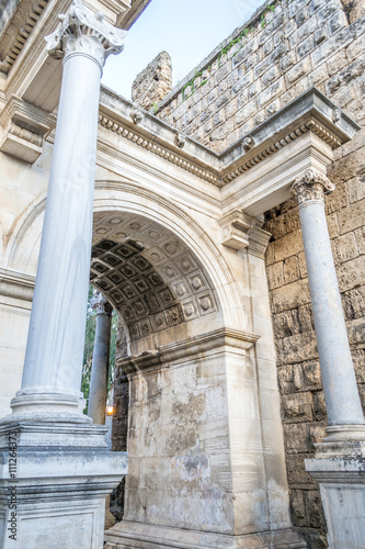 Arch and comlum at Hadrian's gate - 111264373