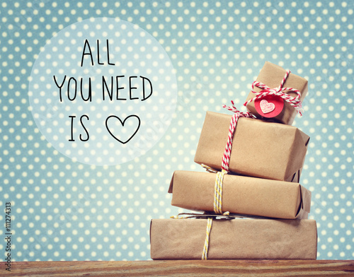 Photo  All You Need Is Love message with gift boxes