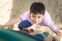 Little Boy Climbing Up Brave A...