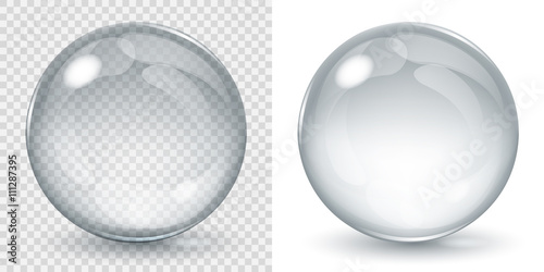 Fototapeta Big transparent glass sphere and opaque sphere with glares and shadow