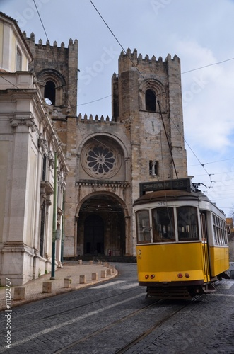 Tram and the Cathedral in Alfama Poster