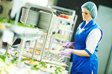 Buffet Female Worker Servicing...