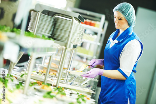 Fotografie, Tablou buffet female worker servicing food in cafeteria