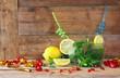 fresh mojito, party confetti and sliced lemons at the bar
