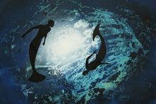 Two Mermaids Circling Underwat...
