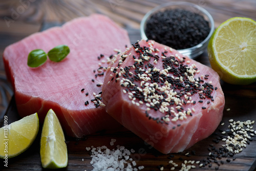Photo  Close-up of two raw fresh tuna steaks, selective focus