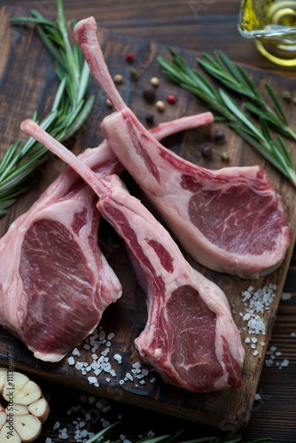 Photo  Close-up of raw fresh seasoned lamb chops, selective focus
