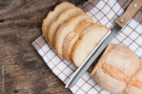 fototapeta na drzwi i meble Sliced homemade bread on rustic wooden table and copy space