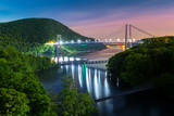 Fototapeta Nowy Jork - Hudson River valley with Bear Mountain bridge illuminated by night, in New York state