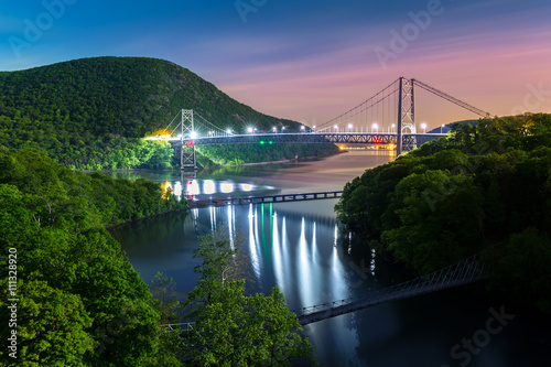 Fotografie, Tablou  Hudson River valley with Bear Mountain bridge illuminated by night, in New York