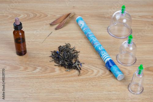 Valokuva  Acupuncture needles, moxa sticks, macerated oil, herbs TCM