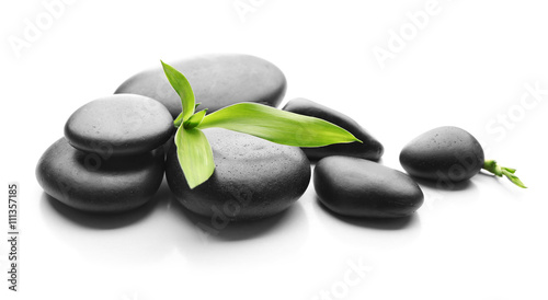 Photo  Heap of spa hot stones isolated on white