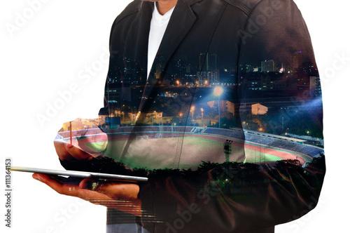 Fotografía  Double exposure of Businessman use Digital Tablet with Sport Sta
