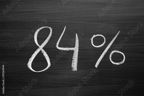 Fotografia  84 percent header written with a chalk on the blackboard
