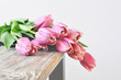 Bouquet of pink tulips on the table.