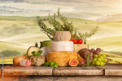 Photo sur Toile Vin Delicious cheeses on old wooden table.
