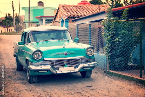 Old classic american car in a street of Vinales, Cuba Plakát