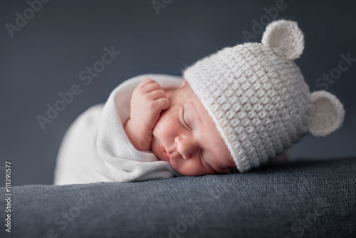 Newborn baby 2 weeks old sleeping on soft blue  fluffy blanket
