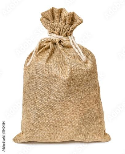 Fototapeta Jute bag full of money isolated on white background.