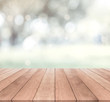 Wooden table top and white bokeh background
