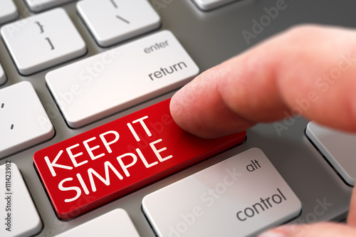 Fotografie, Obraz  Finger Pressing a Modern Laptop Keyboard Key with Keep It Simple Sign