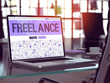 Freelance - Closeup Landing Page in Doodle Design Style on Laptop Screen. On Background of Comfortable Working Place in Modern Office. Toned, Blurred Image. 3D Render.