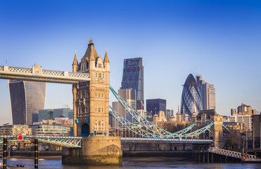 Fototapeta Londyn London, England - Iconic Tower Bridge in the morning sunlight with Bank District at background