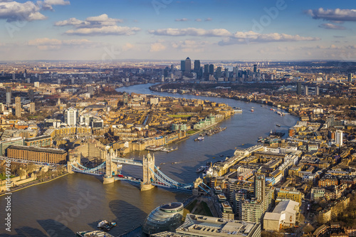 London aerial skyline view including Tower Bridge with red Double Decker Bus, skyscrapers of Canary Wharf and River Thames - 111449746