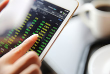 Making Trading Online On The Tablet With Business Woman Hand